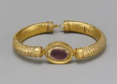 Bracelet with central medallion, Hellenistic, 2nd century B.C.  Greek  Gold, glass  Diam. 3 7/16 in. (8.7 cm)  Purchase, The Concordia Foundation Gift and Marguerite and Frank Cosgrove Jr. Fund, 2001 (2001.230)
