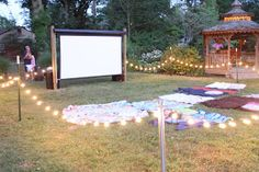 Outdoor movie themed birthday party! This is sweet:)