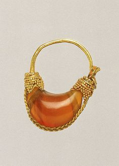 Gold and carnelian boat-shaped earring  Period: Classical Date: 5th–4th century B.C. Culture: Greek Medium: Gold, carnelian Dimensions: Other: 15/16in. (2.4cm)