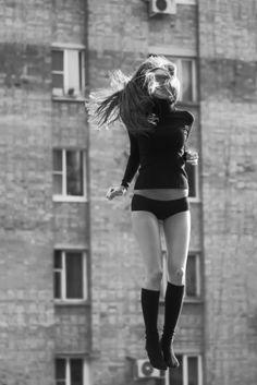 jump | jumping | high | playing playful | black | long socks | turtle neck | urban