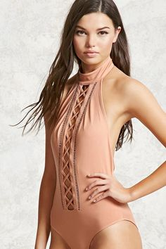 A stretch-knit sleeveless bodysuit featuring lattice and ladder cutouts on  the front 289ca9a13