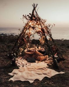 A pole teepee as simple to fashion as the ones you made in childhood, but decorated to be a romantic sanctuary. {Blanket Forts for Adults}