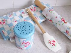 The kitchen items are adorable in rose flowers