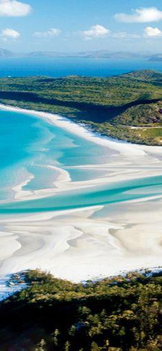 Whitehaven Beach on Whitsunday Island in Queensland, Australia • photo / video…