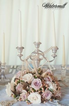 Candles and flowers to give the table that vintage feel! What type of flowers say 1920s to you? #vintage #1920style