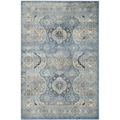 Stylishly anchor your living room or master suite with this lovely art silk rug, showcasing an ornate Persian design in light blue.