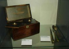"""Tea was so valuable in Jane's era that it was kept in a locked 'tea caddy' like this one, and Jane was the keeper of the key. ... A small brass or silver scoop called a tea ladle was used to measure out the tea leaves. In 1808, Jane Austen recorded her mother's purchase of 'a silver tea ladle' and '6 whole teaspoons which makes our sideboard border on the magnificent.'"" - Syrie James http://austenauthors.net/jane-austens-house-museum-my-visit-in-pictures"