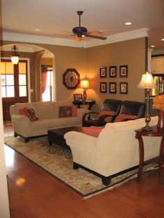 Tan family room with ceiling fan (considering a ceiling fan in my tan family room)