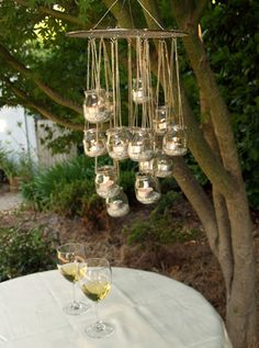 Here's a simple DIY garden chandelier tutorial from Ecologue. It's a great way to reuse little glass jars you may already have at home. food ideas cheap mason jars 8 Genius Ways to Recycle Baby Food Jars Lustre Exterior, Outdoor Chandelier, Chandelier Ideas, Hanging Chandelier, Hanging Candle Chandelier, Chandeliers, Hanging Centerpiece, Chandelier Creative, Rustic Chandelier