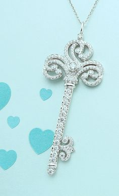 Unlock love's mysteries. Tiffany Enchant® heart key pendant in platinum with diamonds.