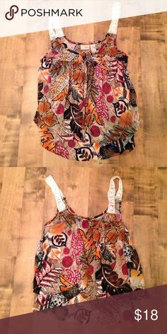 Daytrip tank from the Buckle. Size XS. Cute BKE flowy tank with cream crochet straps. Leaf design. Two tiers in the front & the back has two tiers overlapping that are asymmetrical to show off your lower back a bit. Super cute!! Never worn.  100% polyester Daytrip Tops Tank Tops