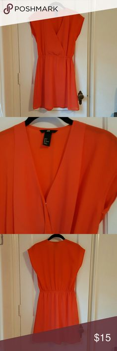H&M orange dress Cute orange dress for a spring or summer day! Has an elastic waist for comfort and a small hidden clasp to help keep the front of the dress closed. It has two layers, with the inside layer being a lining! H&M Dresses Mini