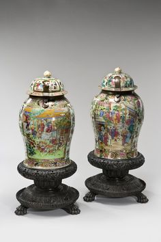Matched pair of Cantonese enameled porcelain standing jars. (China)