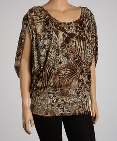 On-trend animal print complements curves in style that can't be denied. With a classic scoop neck and a figure-flattering cut, this top will be finishing ensembles in unforgettable style. Measurements (size 1X): 31'' long from high point of shoulder to hemMannequin measurements: 5'4'' tall; chest 41''; waist 31.75''; hips 39''