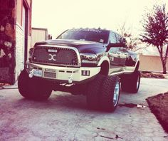 Black Massive lifted Ford Powerstroke diesel truck  may not be in the F-350 but certainly a nice monster Ford truck !!!