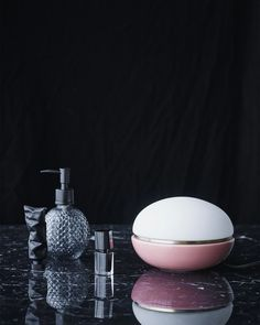 """Inspired by the French delicacy, """"le macaron"""", the Macaroon lamp series gives rooms an elegant and simple touch by balancing opal glass, a brass ring and ceramic. Created by industrial designer Christian Troels. MATERIAL Opal glass + ceramic + brass SIZE Ø 18 cm CARE INSTRUCTIONS Clean the lamp with a damp cloth added"""
