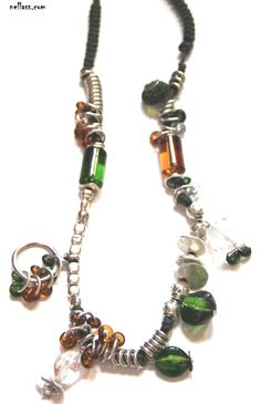 """#Collar """"Verdambar"""" realizado con cuentas #zamak, baño de #plata, #resina e hilo de algodón. P.V.P. 40€  http://nellass.com/products/collar-verdambar-mediano%2C-74cm.html"""