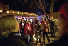 Vecinos participate in  the Lighting of Ledoux in Taos, NM