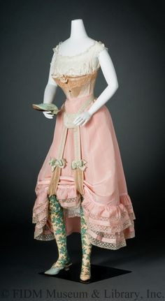 In this undergarments ensemble: Corset by F.S. Thomas & Co. 1898-1903, Garters, 1895-1905, Petticoat, 1895-1900, Silk stockings, 1875-1899.