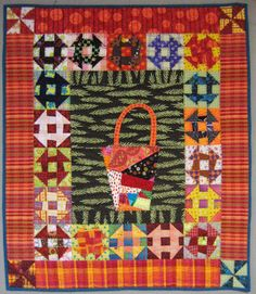 """Sujata's Basket"" quilt at Nifty Quilts. Monkey Wrench (churn dash) blocks surround a free-pieced basket.."