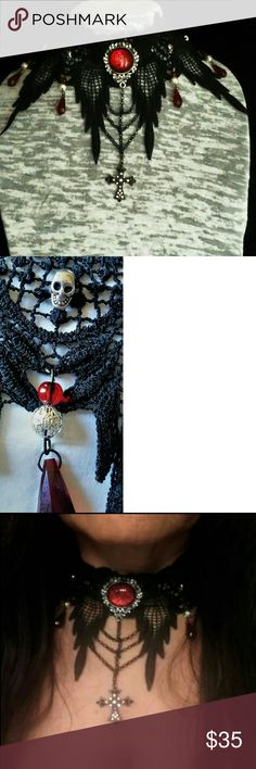 Stunning hand crafted  Gothic  lace choker. This stunner is  hand crafted by me. It is made with soft Victorian lace, hand sewn  tiny silver skulls, and crystal blood red drops. The cabochon  at the throat is hand painted in blood red shimmer. Draped across  the bottom are black chain forming a small web. Ending in a silver rhinestone  cross. Jewelry Necklaces