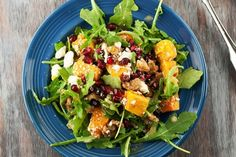 A light salad made with creamy roasted butternut squash, peppery arugula, salty feta, crunchy walnuts and tart pomegranate arils. Seriously good salad!