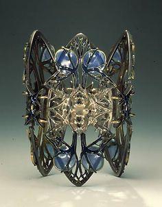 Bracelet |  René Jules Lalique. ca 1900.  Silver, gold and enamel