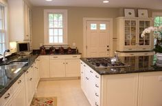 off white kitchen cabinets with tile floor