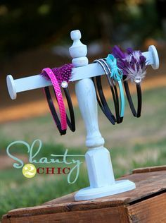 Headband holder - I think this is the next project in order.  I am too ocd to have those stretchy headbands just hanging from hooks off the bottom of my new hairbow frame : )  this seems like a good alternative