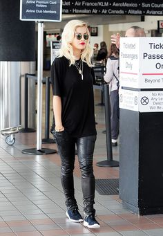 Black TShirt. Black Leather Pants. Sneakers. Urban Fashion. Urban Outfit. Hip Hop Fashion. Hip Hop Outfit. Swag. Dope. Sneakers Outfit. Rita Ora Style .... I just wouldn't wear those shoes with it.