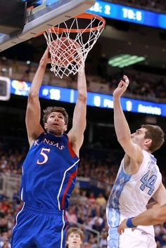 ST LOUIS, MO - MARCH 25:  Jeff Withey #5 of the Kansas Jayhawks dunks in the first half against Tyler Zeller #44 of the North Carolina Tar Heels during the 2012 NCAA Men's Basketball Midwest Regional Final at Edward Jones Dome on March 25, 2012 in St Louis, Missouri.  (Photo by Andy Lyons/Getty Images)
