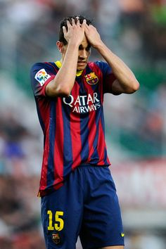 Marc Bartra of FC Barcelona reacts during the La Liga match between Elche FC and FC Barcelona at Estadio Manuel Martinez Valero on May 11, 2014 in Elche, Spain.