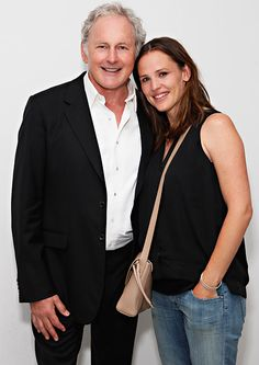 Victor Garber poses with actress Jennifer Garner backstage following his performance at 54 Below on August 13, 2012 in New York City.
