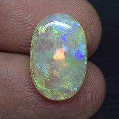 6.08 Ct. HOT Rainbow Natural Oval Cabochon Multi-color Opal Australian Loose Gemstone Size: 18.6×12.2×4.1 mm. (Long x Wide x Height), Weight : 6.08 Ct.