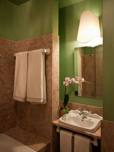 The natural stone and green walls work wonders together