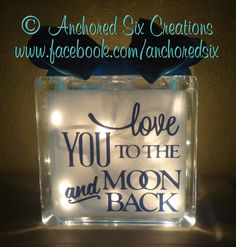 Glass Block, featuring love you to the moon and back on the front in high quality vinyl. A mini string of lights is placed inside of the