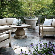 Veranda among the treetops. I love the Wood patio furniture.