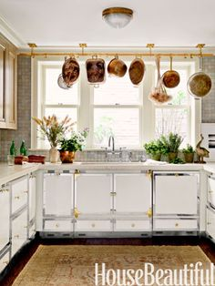 A polished brass pot rack brightens up the basement kitchen of this 19th-century New York town house. Design: Carey Maloney and Hermes Mallea