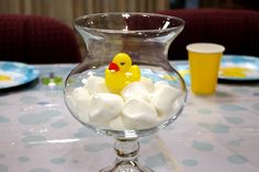 Willow House small Madeline Hurricane centerpiece decorated for a baby shower by adding marshmallows and a rubber duck. #baby_shower #duck #centerpiece