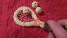 Small crochet tennis racquete mascot with three smiling balls via Ariadne. Click on the image to see more!