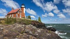 red brick lighthouse on a cliff overlooking the sea - clouds, brick, cliff, waves, lighthouse, sea