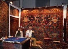 The Norwegian antique rug dealer Lars Nygaard in his stand.