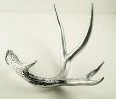 chrome painted antler. Or high gloss black.