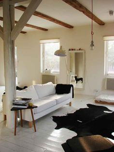 i love how simple wood beams make a space look so much more wide open
