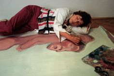 Maria Lassnig painting in her studio in Vienna, 1983, photographed by Michael Westermann
