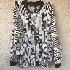 Host pick  Daisy printed jacket Beautiful plus size jacket in black with daisy floral prints with zipper in the front and elastic on the side waist . With side pockets . Same style available in 2x.   Bundle for 10% discounts . Measures Armpit to armpit :26 length :28.  100% polyester Jackets & Coats