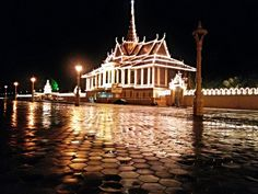 Royal Palace in Phnom Penh Cambodia near Riverfront. The view of the palace at night after a huge flood in the raining season and political demonstration October 2013.