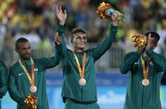 Bronze medalists players of Brazil celebrate on the podium at the medal ceremony for the Football 7-a-side - Men's Gold Medal Match - Ukraine and Iran at Deodoro Stadim during day 9 of the Rio 2016 Paralympic Games on September 16, 2016 in Rio de Janeiro, Brazil.
