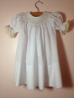 Baby Girl Smocked Bishop Dress 6 mo. DMC floss, lace and Imperial broadcloth. This lady does beautiful work!