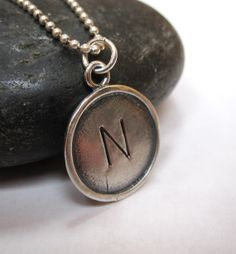 LOVING THIS  Rustic rimmed sterling silver disc necklace by underhercharm, $40.00